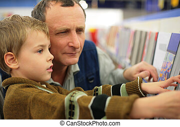 succession - Grandfather with grandson in bookstore