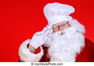 cook santa - Jolly Santa Claus in a chef's hat over festive...