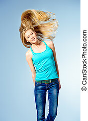 jumping young girl - Pretty girl teenager jumping at studio...