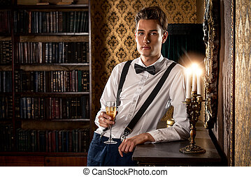 nobleman - Elegant young man stands by the fireplace in a...