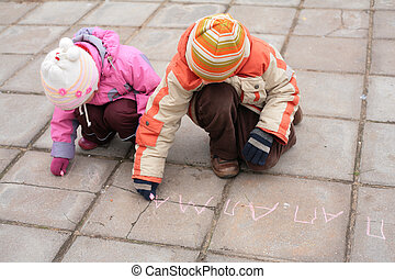 Two children with chalk on road