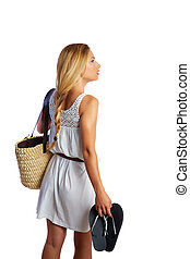 Blond tourist girl with flip flop shoes white dress