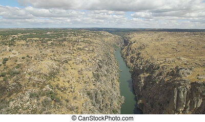 Aerial view approaching to cliff in Duero River, Spain -...