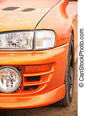 Orange sport car. Close up.