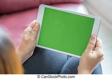 Woman hands holding tablet pc with green screen