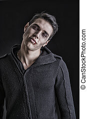 Portrait of a Young Vampire Man with Black Sweater, Looking...