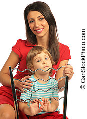 Girl and woman astride chair