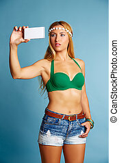 Blond long hair girl with jeans shorts selfie photo with...