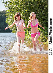 Two girl runs on water