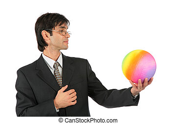 Businessman with multicolor ball