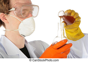 View on scientist in respirator and rubber gloves pours...