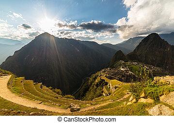 Sunlight on Machu Picchu from above, Peru - Machu Picchu...