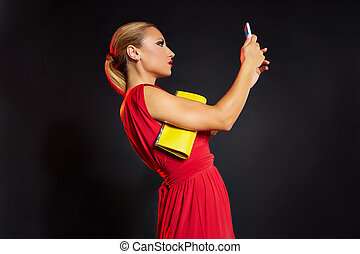 Blond fashion woman selfie photo in smartphone