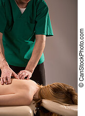 Lady relaxing during pleasant massage