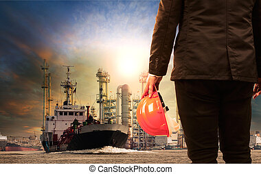 working man and oil refinery with lpg gas storage ship...