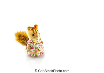 Squirrel toy wear pink dress on a white background