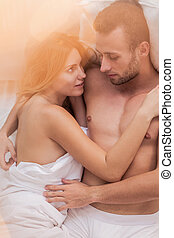 Husband and wife in bed - Husband and wife lying in bed,...