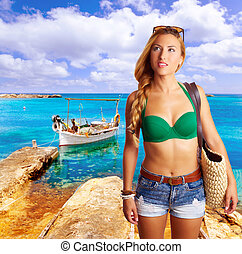 Blond sexy tourist girl in tropical beach Formentera