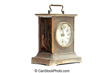 Old broken mantel clock on a white background closeup