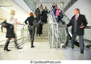 People on  escalator and ladder