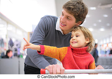 Father with child in  shop