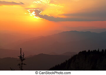 orange sunset over the mountains