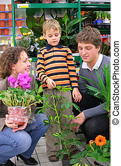 Parents with child in flower shop