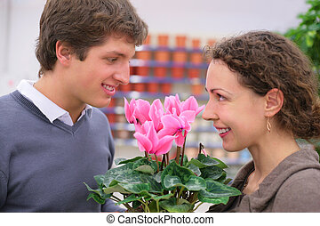 Pair looks against each other in flower shop