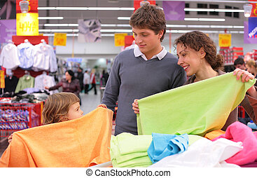 Family choose  fabric in shop