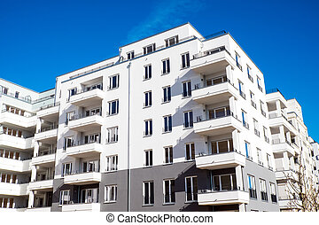 White housing complex in Berlin - A white modern housing...