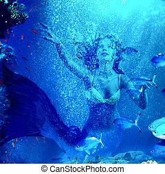 Mermaid dive underwater through coral - Girl mermaid dive...