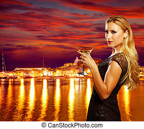 Blond tourist girl drinking vermout cup at Ibiza - Blond...