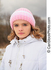 Face of young beauty girl outdoor in winter