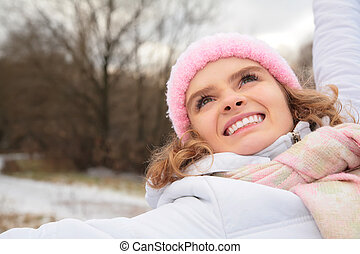 Face of young beauty girl in wood  in winter