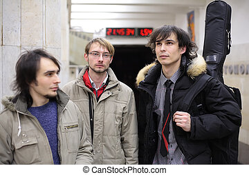 Three young musicians at metro station