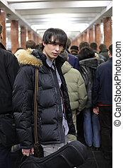Young man at metro station