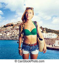 Blond girl tourist in Ibiza skyline summer top