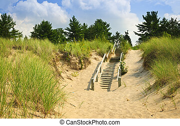 Wooden stairs over dunes at beach. Pinery provincial park,...