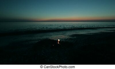 fire inflame the kerosene on the seashore - Add the burning...