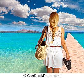 Blond tourist girl in Alcudia beach of Mallorca