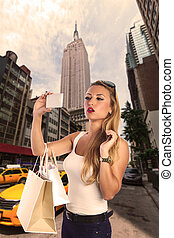 Blond tourist girl selfie photo in New York 5th ave