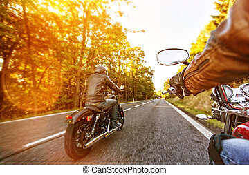 Man seat on the motorcycle on the forest road. - Man seat on...