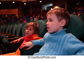 Boy and girl in theater