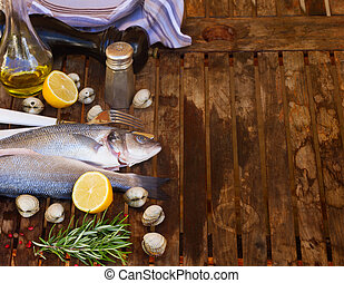 Seabass - Two Seabass raw fish with shellfish and spices,...