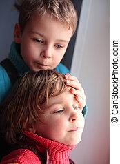 Two pensive children