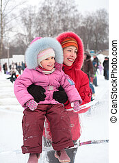 girl on ice slope with mother