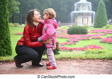 Mother with daughter in park