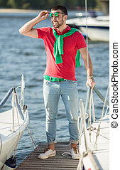 Yacht club - Young successful businessman holding time on...