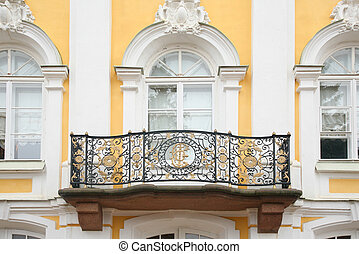 Baroque balcony on  facade of house. Peterhof. Russia.