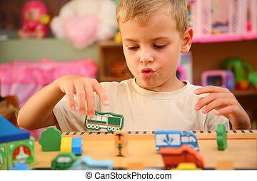 Boy plays  in playroom
